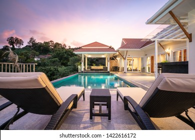home or house Exterior design showing tropical pool villa with sun bed
