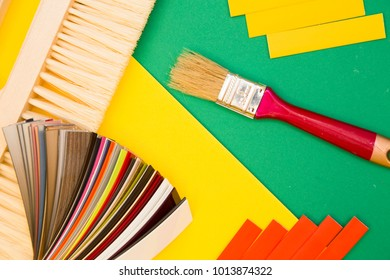 Home, House Repair, Redecorating, Renovating Concept.Brushes, palette of surface color range and wire isolating material in stripes on green background with copy space, top view, flat lay