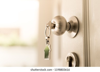 Home and housing estate concept, a key to open the door