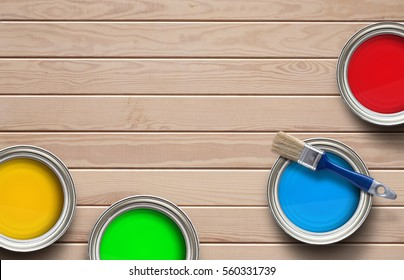 Home improvement, colorful paint cans on the clear wooden background with copy space