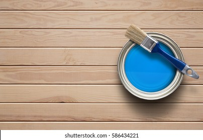 Home improvement, paint can on the clear wooden background with copy space