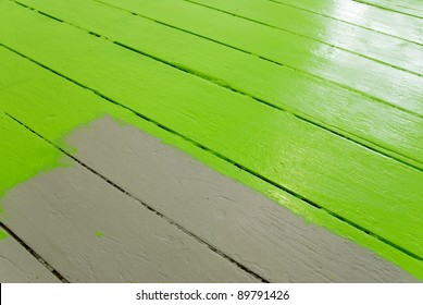 home improvement painting the floor with green paint