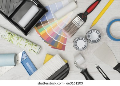 Home improvement painting tools and on a white wooden surface overhead shot