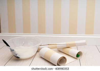 Home improvement scene of wallpaper being prepared to hang on the wall