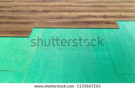 Laminate flooring.Flexible panels of quartz-vinyl flooring in the apartment