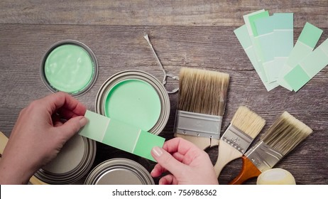 Home inprovement project. Painting wood with turquose color paint.