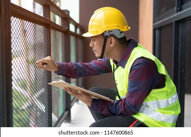 Home inspection consultancy. Inspector checking material of balcony and looking for fracture.