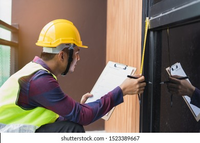 Home inspection consultancy. Inspector checking window installation and sliding window to test.