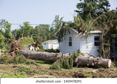 Home insurance. insurance storm.Storm damage.Roof damage from tree that fell over during hurricane storm.A storm causes a white oak tree to fall and rip through the roof of a house. A tree falls.