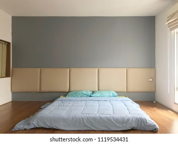 Home interior cozy bedroom in modern design with empty gray wall background.