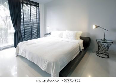 Home interior of cozy bedroom in modern design.
