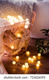 home interior decoration, metal basket with pillow, warm blanket