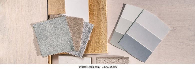 Home interior designer remodel color swatches samples top view panoramic banner background. DIY remodeling renovation of kitchen or living room with furniture choices, wood cabinets, paint colours.