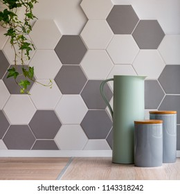 Home interior with hexagonal tiles, wooden countertop and decorative containers