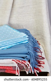 Home interior, tailor, sewing, diy concept. Heap of colorful cloth fabrics. Color Wool, cotton linen clothes. Closeup. Top view