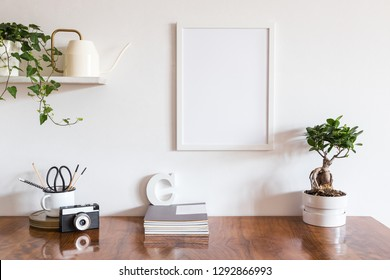 Home interior, wooden desk with stationery, camera, box, bonsai, ivy design watering can and photo frame on white wall mock up