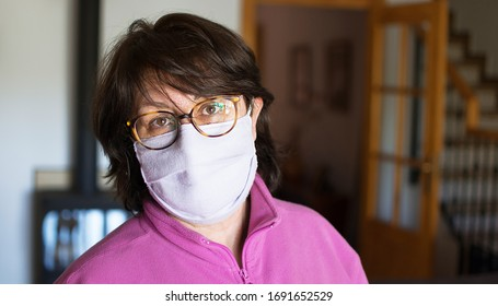 Home isolation. Quarantine COVID-19. Mask Woman  isolated.Pandemic Coronavirus   auto quarantine for virus SARS-CoV-2. voluntary isolation surgical mask on face. Coronavirus Disease 2020. Stay at home