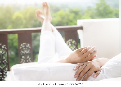 home, leisure, relax and happiness concept - People lying or sitting on sofa at home from back
