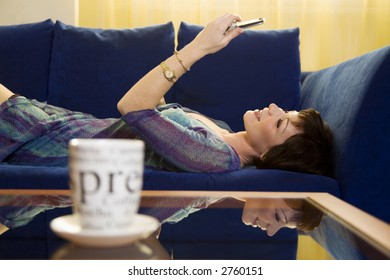 home life: girl playing with her mobile at home