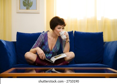home life: girl reading a magazine  at home