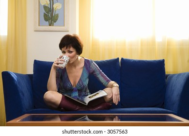 home life: girl relaxing on the coach at home