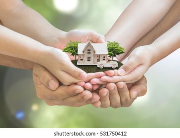 Home loan, car insurance, family life assurance protection, financial mortgage for house building, and legacy planning investment concept with children - parent's hands holding private property