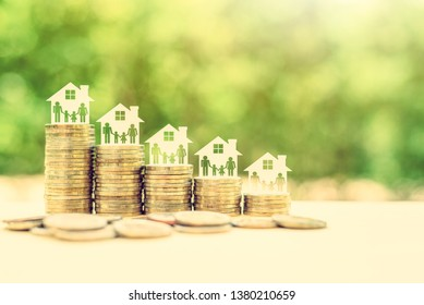 Home loan, cost of living, financial concept : Family members in a house on rows of rising coins, depicts amount of money needed to pay / sustain certain standard of living by affording basic expenses