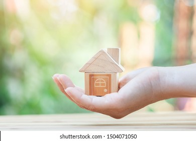 Home loan, home insurance, family life assurance protection, financial mortgage for house building, and legacy planning investment concept with children - parent's hands holding private property