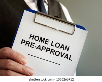 Home loan pre approval and mortgage documents in the hands.