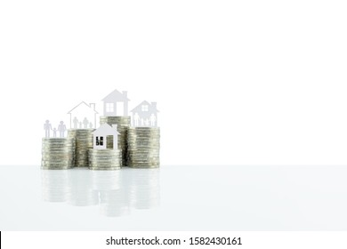 Home loan or refinancing, financial concept : Family in a house on steps of coins, isolated on white background with clipping path, depicts saving money to upgrade assets for better standard of living