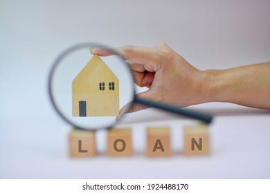 Home loans,saving for a real estate concept,Present by Magnifying glass,home and wooden cube. Loans for real estate or buy a new house in the future.