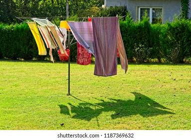 Home loundry dyring on sun in a gardenin garden
