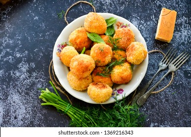 Home made Arancini with tuna . Italian fried rice balls with mozzarella, parmesan cheese , fish  and fresh parsley and dill