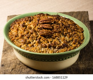 Home made baked sweet potato casserole with pecan topping