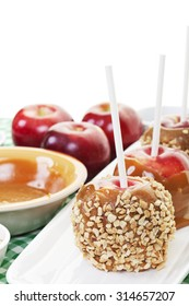 Home made candy apples freshly dipped in smooth, creamy caramel and rolled in crushed peanut bits.