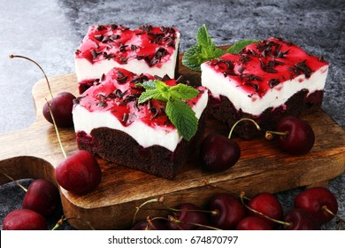Home made cherry cake with vanilla, cream cheese and black cherries on grey background