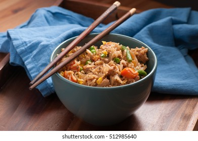 home made chicken fried rice with vegetables and chopsticks