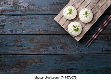 Home made chinese dumplings served with sweet chili sauce over blue wooden background. Top View
