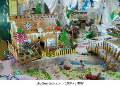 Home made Christmas delicious Gingerbread village with railroad and steam train