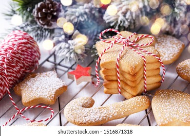 Home made Christmas shortbread or gingerbread cookies on a white wooden surface, horizontal