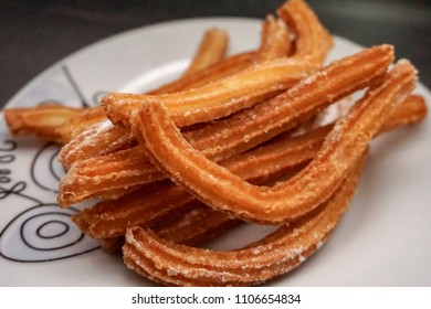 Home made churros with sugar and cinnamon