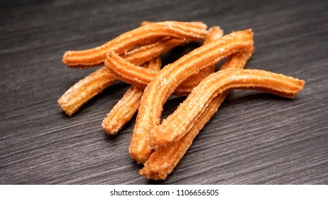 Home made churros with sugar and cinnamon