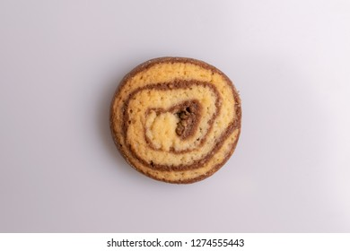 Home made cookie of eliptical shape, made with chocolate, butter and vanilla, isolated on white background, soft light, top view, copy space