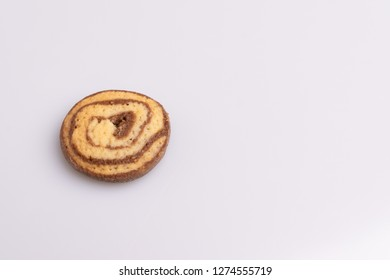 Home made cookie of eliptical shape, made with chocolate, butter and vanilla, isolated on white background, soft light, angle view, copy space