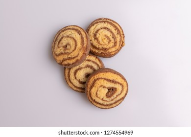 Home made cookies of eliptical shape, made with chocolate, butter and vanilla, isolated on white background, soft light, top view, copy space
