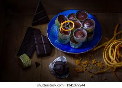 Home made dark chocolate candy with a taste of orange. Dark food photography.