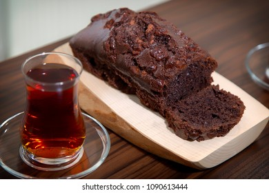 Home made delicious cocoa cake over wooden plate and Turkish tea