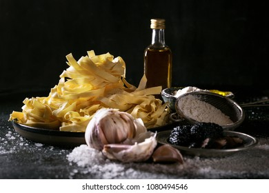 Home made egg pasta served with truffles, garlic truffle infused oil and salt. New concept of raw foods.