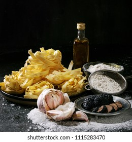 Home made egg pasta served with truffles, garlic truffle infused oil and salt. New concept of raw foods. Square image
