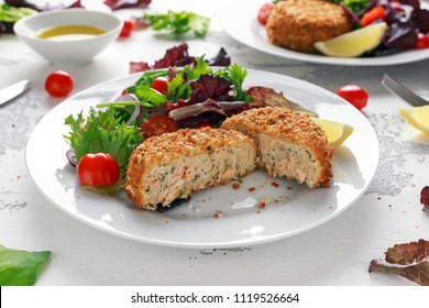 Home made Fish Cake salmon, spinach and potato. served on plate with vegetables